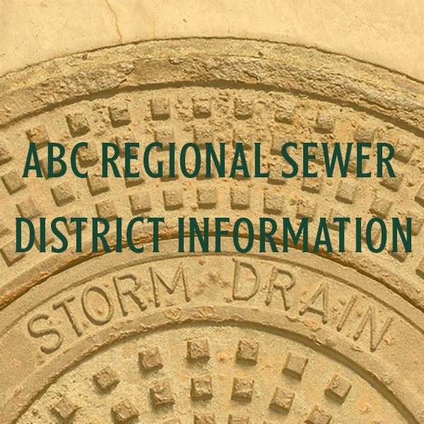 Storm drain cover with abc regional sewer district text