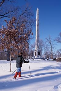 Walking Through the Snow in Front of the Obelisk