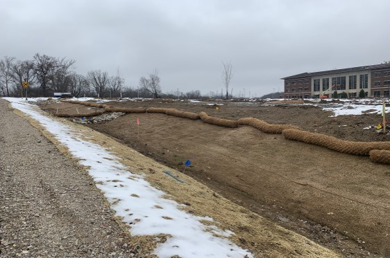 Erosion control and straw wattles to prevent sediment from entering drainage swale