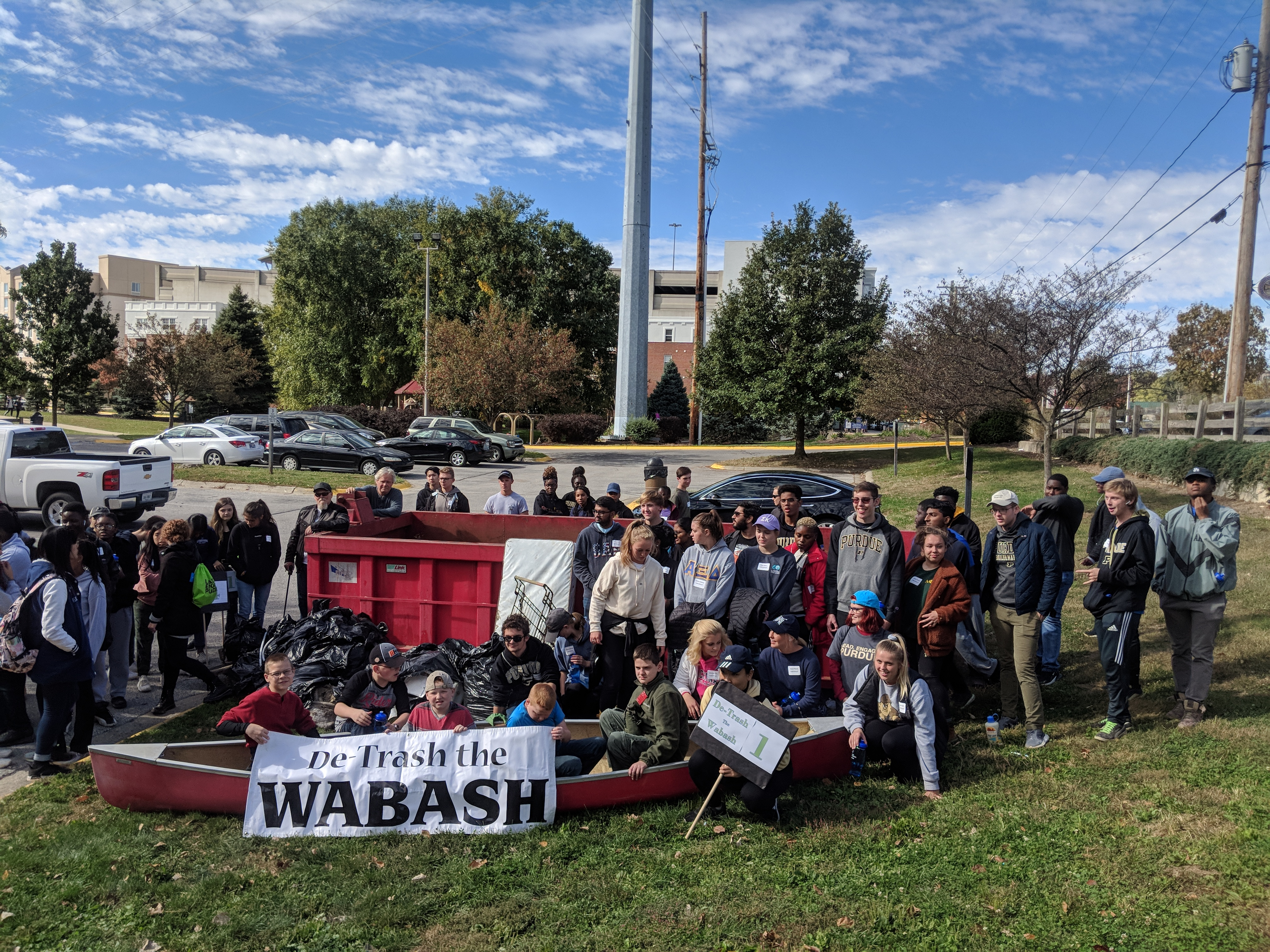 Volunteers pose with the trash removed from the Wabash River