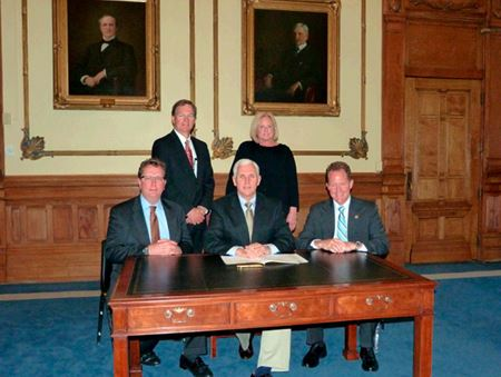 Governor Mike Pence with state representatives signs Bill 352 into law in 2013.